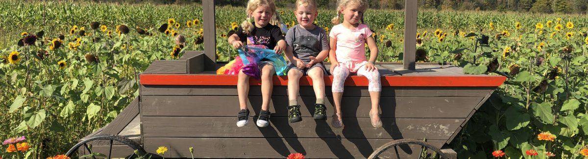 Kids on wagon at Pumpkinville